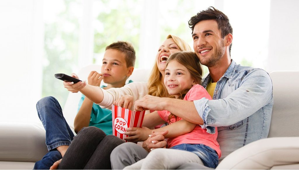 home builder marketing: family watching TV together
