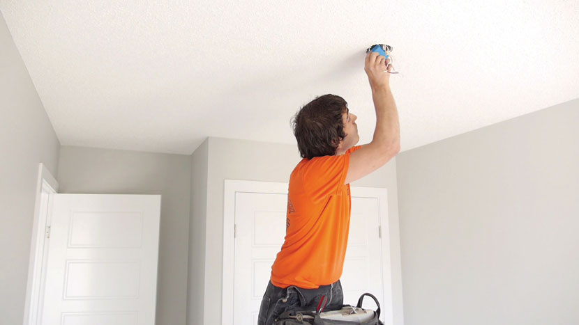 image of electrician installing smart home lighting