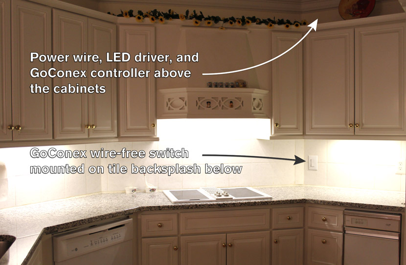Photo illustrating installation components and locations for a wireless light switch on a kitchen backsplash